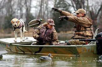 Duck hunters throwing out decoys